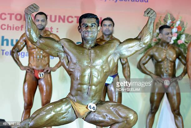 Indian bodybuilder A Dinesh from southern Tamil Nadu state and winner of the '31st All India Postal Best Physique' title flexes his muscles during...