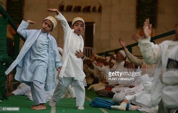 Indian Bohra Muslim children react during a speech by the community's new spiritual leader Syedna Mufaddal Saifuddin at a mosque in Mumbai on...