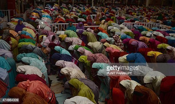 Indian Bohra Muslim women pray following a speech by their new spiritual leader Syedna Mufaddal Saifuddin at a mosque in Mumbai on February 26 2014...