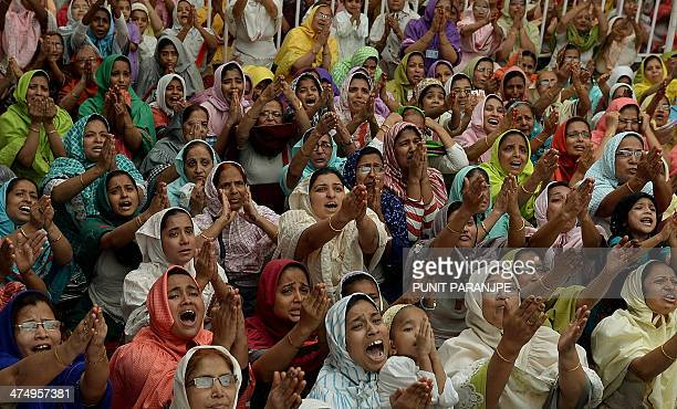 Indian Bohra Muslim women react as their new spiritual leader Syedna Mufaddal Saifuddin appears in front of them at a mosque in Mumbai on February 26...