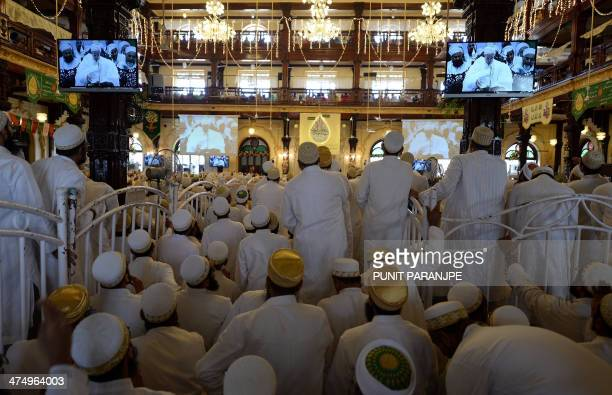 Indian Bohra Muslims listen to a speech by the community's new spiritual leader Syedna Mufaddal Saifuddin at a mosque in Mumbai on February 26 2014...