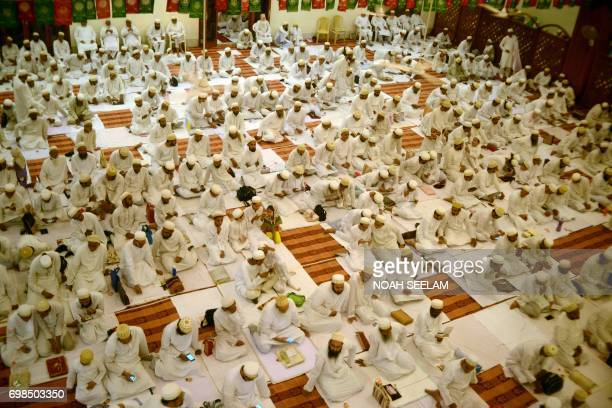 Indian Bohra Muslims offer prayers before breaking their fast at Saifee Masjid in Secunderabad on June 20 2017 India's Dawoodi Bohra community...