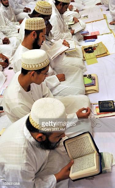 Indian Bohra Muslims read the Koran as they offer Eid prayers at the Fatemi Mosque in Hyderabad early on September 9 2010 Bohras adhere to the Shia...