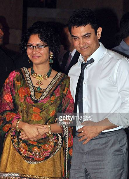 Indian Bollywood Aamir Khan with wife Kiran Rao attend the wedding reception of actors Ritesh Deshmukh and Genelia D'Souza in Mumbai on February 4...