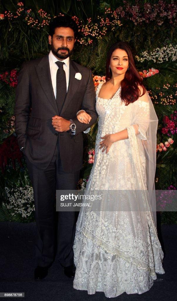 Indian Bollywood Aators Abhishek Bachchan L And Aishwarya Rai Pose For A Photograph