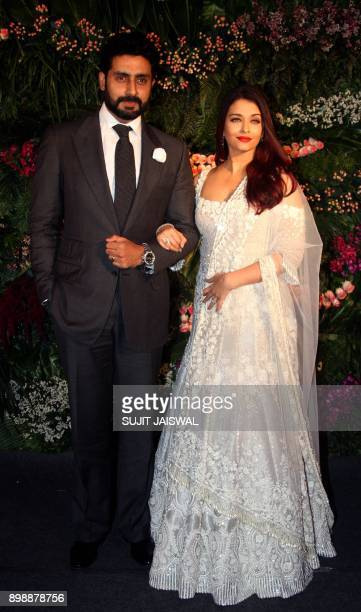 Indian Bollywood Aators Abhishek Bachchan and Aishwarya Rai Bachchan pose for a photograph during the wedding reception of the Bollywood actress...