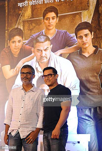 Indian Bollywood actor Aamir Khan attends the poster launch of his upcoming biographical sports drama 'Dangal' directed by Nitesh Tiwari in Mumbai on...