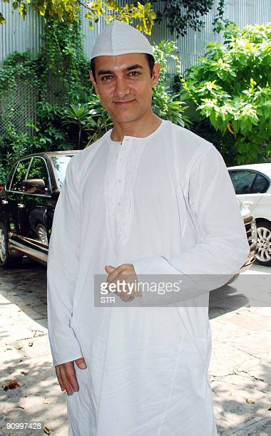 Indian Bollywood actor Aamir Khan celebrates Eid alFitr at his home in Mumbai on September 21 2009 The festival marks the end of the holy Muslim...