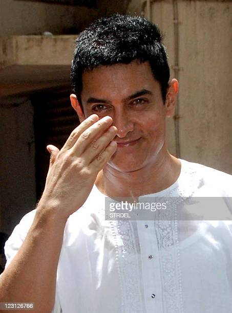 Indian Bollywood actor Aamir Khan gestures at his residence during Eid alFitr in Mumbai on August 31 2011 AFP PHOTO/STR