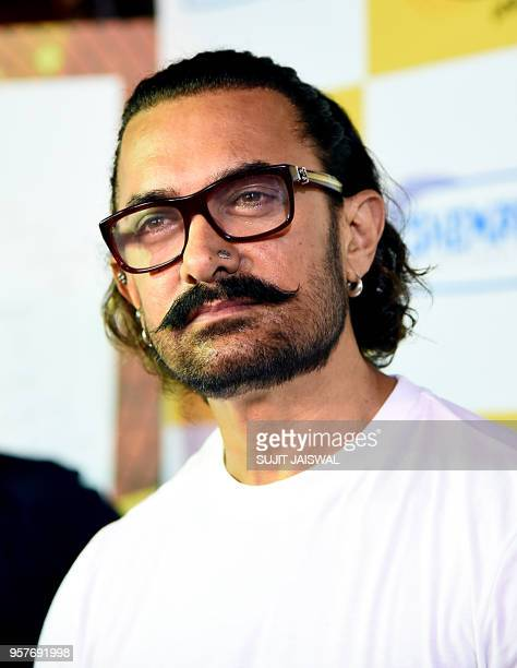 Indian Bollywood actor Aamir Khan looks on during the 30th anniversary event for his debut Hindi film 'Qayamat Se Qayamat Tak' in Mumbai on May 12...