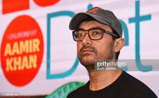 Indian Bollywood actor Aamir Khan looks on during the launch of a book about weight loss in Mumbai on March 27 2019