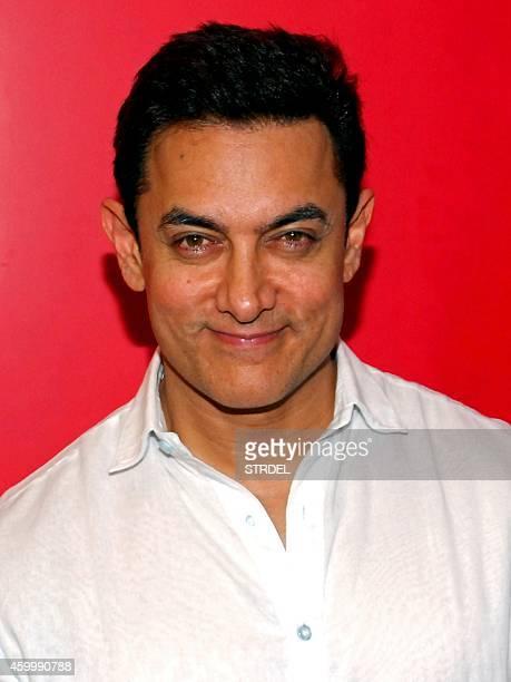 Indian Bollywood actor Aamir Khan poses during press meet for his upcoming Hindi film 'PK' in Mumbai on December 5 2014 AFP PHOTO/STR