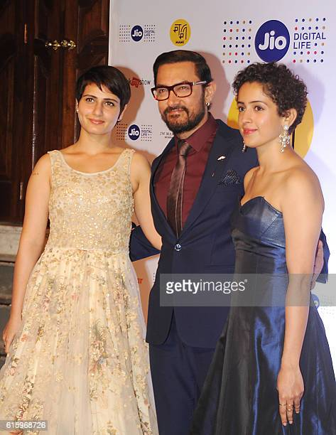 Indian Bollywood actor Aamir Khan with actress Fatima Sana Shaikh and Sanya Malhotra attend the Jio MAMI 18th Mumbai Film Festival opening ceremony...