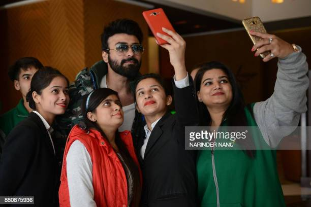 Indian bollywood actor Aarya Babbar along with his fans takes a selfie during a promotional event for the upcoming bollywood film 'Tera Intezaar' at...