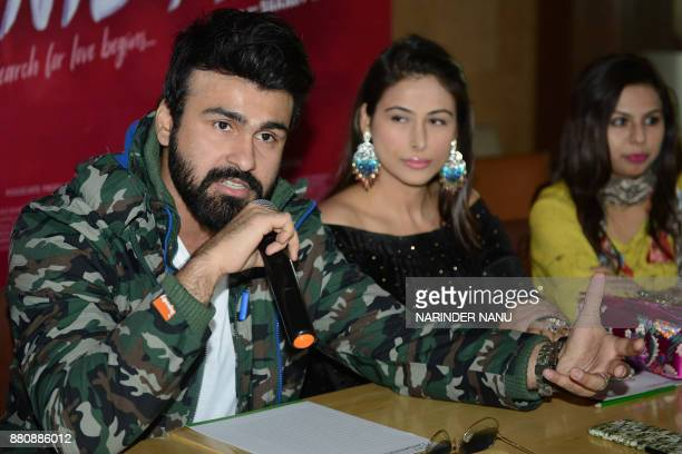 Indian bollywood actor Aarya Babbar and actress Bhani Singh address the media during a promotional event for the upcoming bollywood film 'Tera...