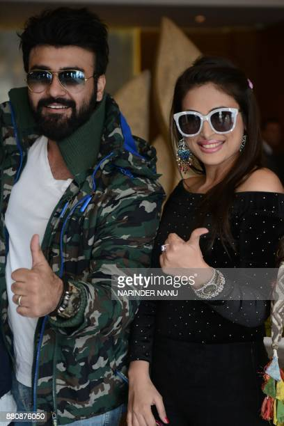 Indian bollywood actor Aarya Babbar and actress Bhani Singh pose for a photograph during a promotional event for the upcoming bollywood film 'Tera...
