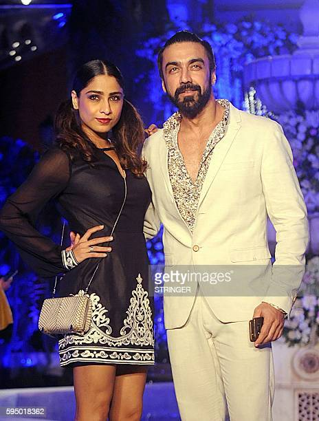 Indian Bollywood actor Aashish Chaudhary and his wife attend the Lakme Fashion Week Winter/Festive 2016 in Mumbai on August 24 2016 / AFP / STRINGER