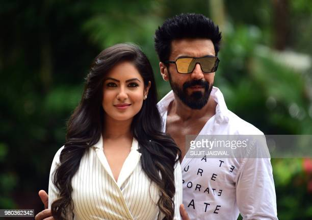 Indian Bollywood actor Aashish Chaudhary and television actress Pooja Banerjee pose during the promotion of 'Dev' season 2 aired on Colors TV in...