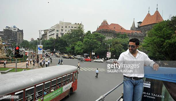 Indian Bollywood actor Abhishek Bachchan gestures as he stands on top of a bus during a promotional event for the forthcoming film 'Raavan' in Mumbai...