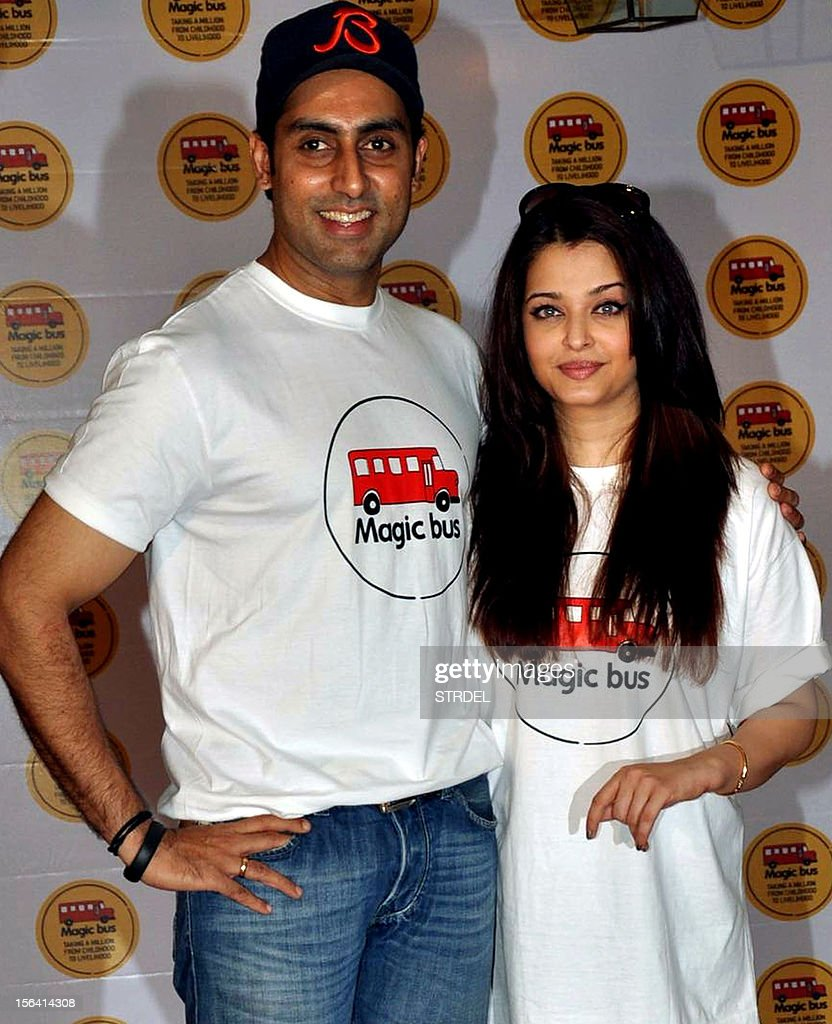 Indian Bollywood actor Abhishek Bachchan (L) poses with his wife Aishwarya Rai Bachchan on the occasion of Children's Day in Mumbai late November 14, 2012.