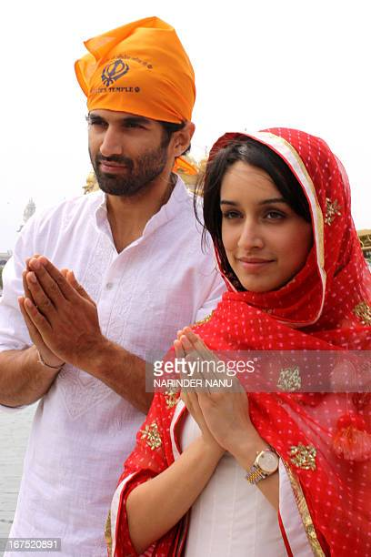 Indian Bollywood actor Aditya Roy Kapoor and actress Shraddha Kapoor pose for a photo near the Sikh Shrine the Golden temple in Amritsar on April 26...