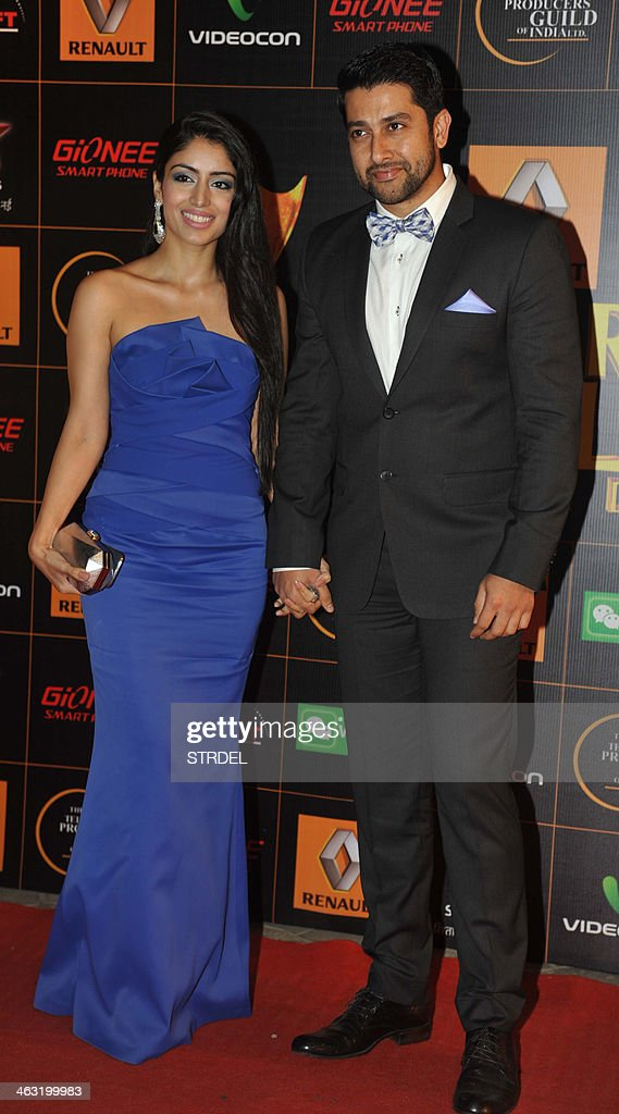 Indian Bollywood actor Aftab Shivdasani (R) and his partner Nin Dusanj pose for a photograph during the Renault Star Guild Awards ceremony in Mumbai on late January 16, 2014.