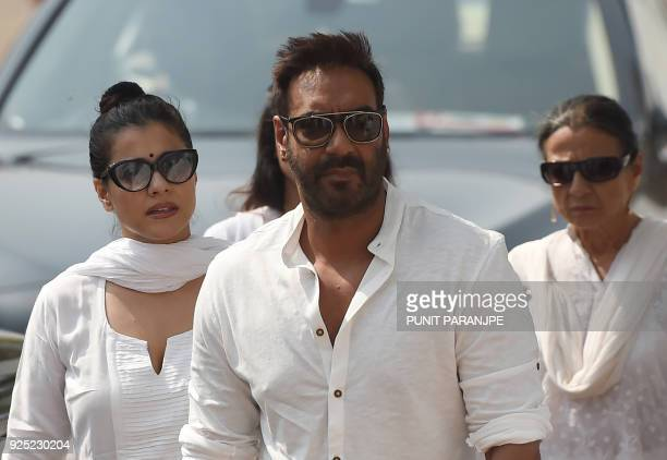 Indian Bollywood actor Ajay Devgan and his wife Kajol arrive to pay their last respects to the late actress Sridevi Kapoor ahead of her funeral in...