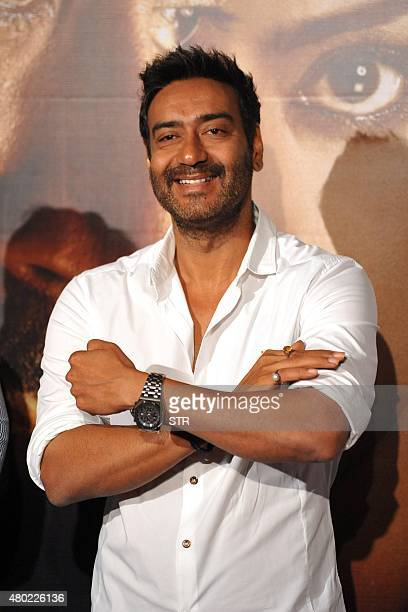 Indian Bollywood actor Ajay Devgn poses during the poster and song launch of the upcoming Hindi film 'Drishyam' directed by Nishikant Kamat in Mumbai...