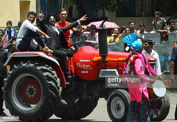 Indian Bollywood actor Akshay Kumar and British model and actress Amy Jackson take part in a promotional event for the forthcoming Hindi film 'Singh...