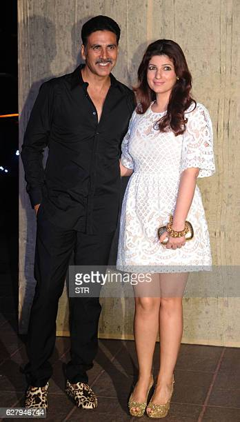 Indian Bollywood actor Akshay Kumar and his wife Twinkle Khanna pose for a photograph during designer Manish Malhotra's 50th birthday in Mumbai on...