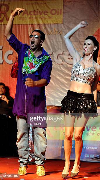 "Indian Bollywood actor Akshay Kumar dances with German model Claudia Ciesla during a promotional event for the forthcoming Hindi film ""Khiladi 786""..."