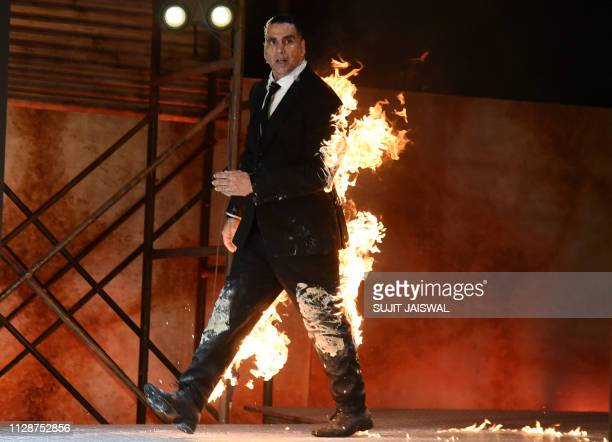 TOPSHOT Indian Bollywood actor Akshay Kumar performs a fire stunt during the announcement of the upcoming series 'The End' of Amazon Prime Video in...