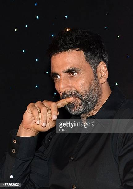 Indian Bollywood actor Akshay Kumar poses during the unveiling of author Amish Tripathi's new book cover 'Scion of Ikshvaku' in Mumbai on March 27...