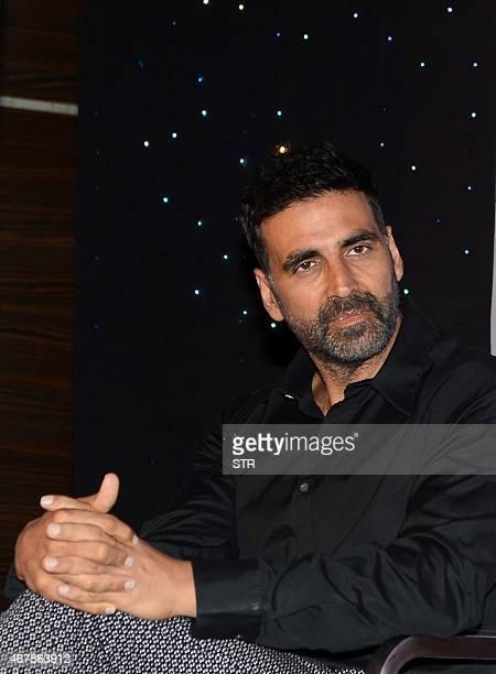Indian Bollywood actor Akshay Kumar poses during the unveiling of author Amish Tripathi's new book cover 'Scion of Ikshvaku' in Mumbai on March 27...