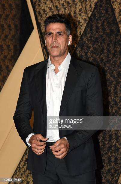 Indian Bollywood actor Akshay Kumar poses for a picture during the wedding reception of film producer Mukesh Bhatt's daughter Sakshi Bhatt in Mumbai...
