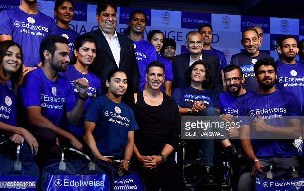 Indian Bollywood actor Akshay Kumar poses for with Indian athletes during an event to wish good luck to Indian athletes for the 2018 Asian Games in...