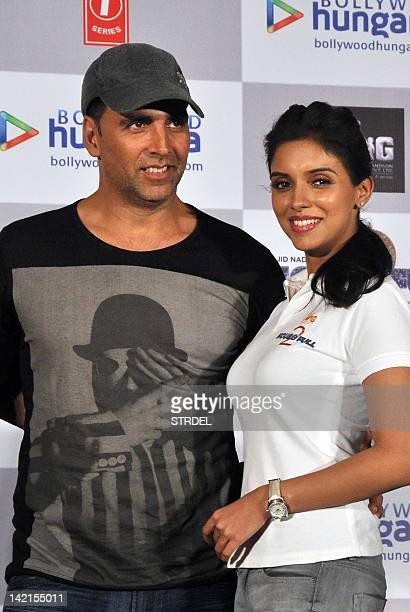 "Indian Bollywood actor Akshay Kumar poses with actress Asin during the promotion for the forthcoming Hindi film ""Housefull 2"" in Mumbai late March..."