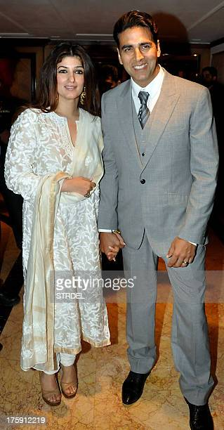 Indian Bollywood actor Akshay Kumar poses with his wife Twinkle Khanna during the unveiling of a statue of the late Bollywood actor Rajesh Khanna in...
