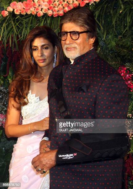 Indian Bollywood actor Amitabh Bachchan and his daughter Shweta pose for a photograph during the wedding reception of the Bollywood actress Anushka...