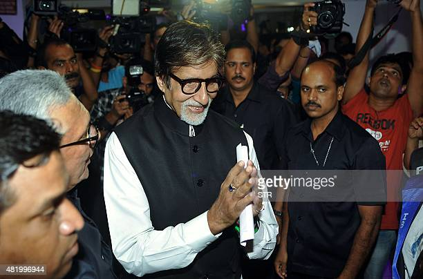 Indian Bollywood actor Amitabh Bachchan greets during the inauguration of Jamnabai Narsee International School in Mumbai on July 25 2015 AFP PHOTO