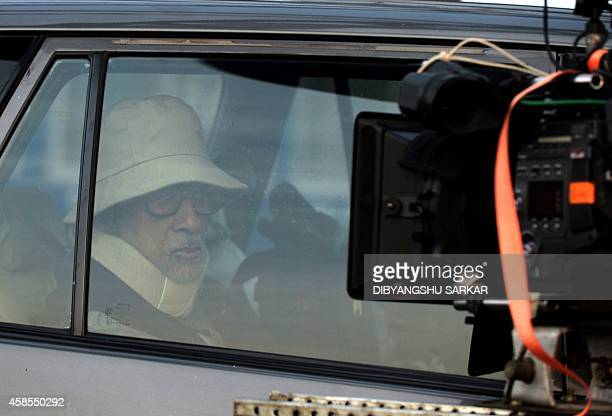 Indian Bollywood actor Amitabh Bachchan sits inside a car during the shooting of a scene for the film 'Piku' on Howrah Bridge in Kolkata on November...