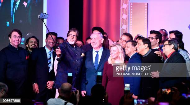 Indian Bollywood actor Amitabh Bachchantakes a selfie picture with a selfie stick with Israel Prime Minister Benjamin Netanyahu , his wife Sara and...