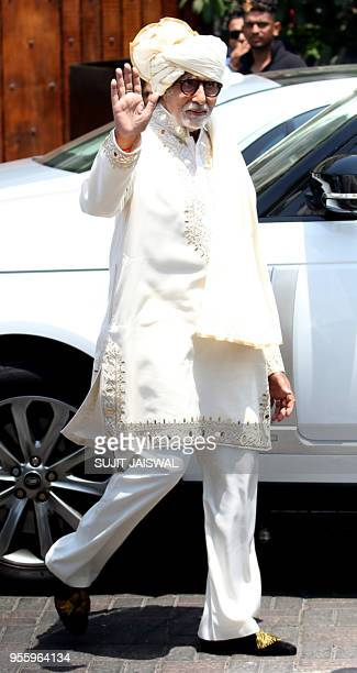 Indian Bollywood actor Amitabh Bchchan arrives ahead of the marriage ceremony of Bollywood actress Sonam Kapoor in Mumbai on May 8 2018
