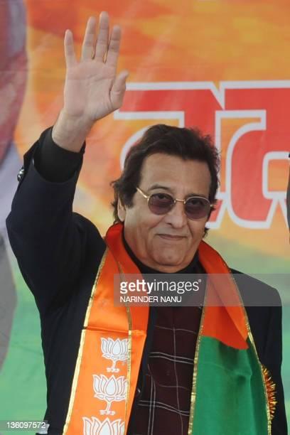 Indian Bollywood actor and Bhartiya Janata Party leader Vinod Khanna waves during a BJP rally at Rama Mandi in Jalandhar on December 24 2011 The...