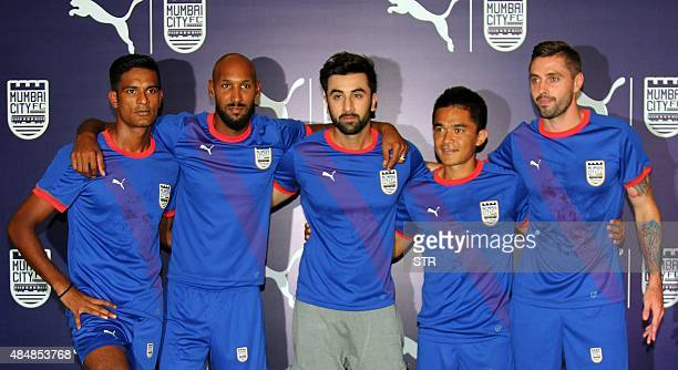 Indian Bollywood actor and coowner of Mumbai City Football Club Ranbir Kapoor poses with player Subrata Paul France's Nicolas Anelka Sunil Chhetri...