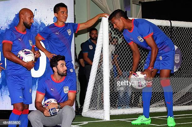 Indian Bollywood actor and coowner of Mumbai City Football Club Ranbir Kapoor poses with France's Nicolas Anelka and Sunil Chhetri Subrata Paul at...
