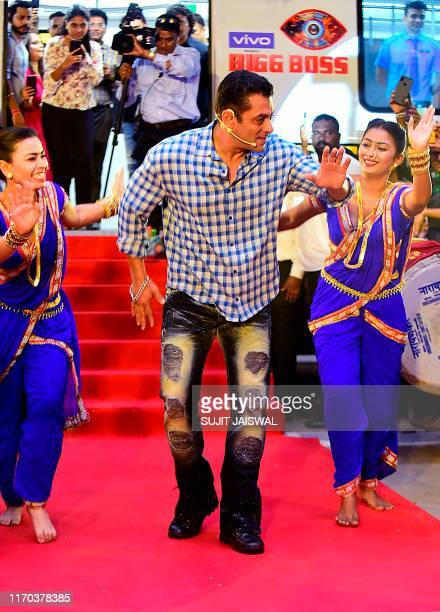 Indian Bollywood actor and host of reality television program Bigg Boss season 13 Salman Khan dances during the show's press conference at Metro...