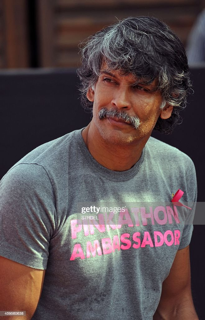 Indian Bollywood actor and model Milind Soman looks on during a promotional event for the Pinkathon women's marathon in Mumbai on November 25. 2014.