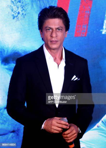 Indian Bollywood actor and producer Shah Rukh Khan poses for a picture during a promotional event of upcoming thriller Hindi film 'Ittefaq' in Mumbai...
