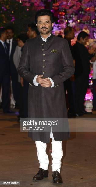Indian Bollywood actor Anil Kapoor poses for a picture as he attends the preengagement party of India's richest man and Reliance Industries Limited...